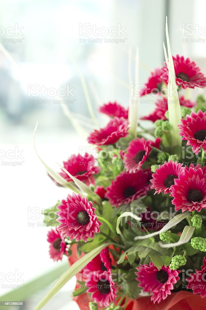 pink artificial Flowers in office royalty-free stock photo