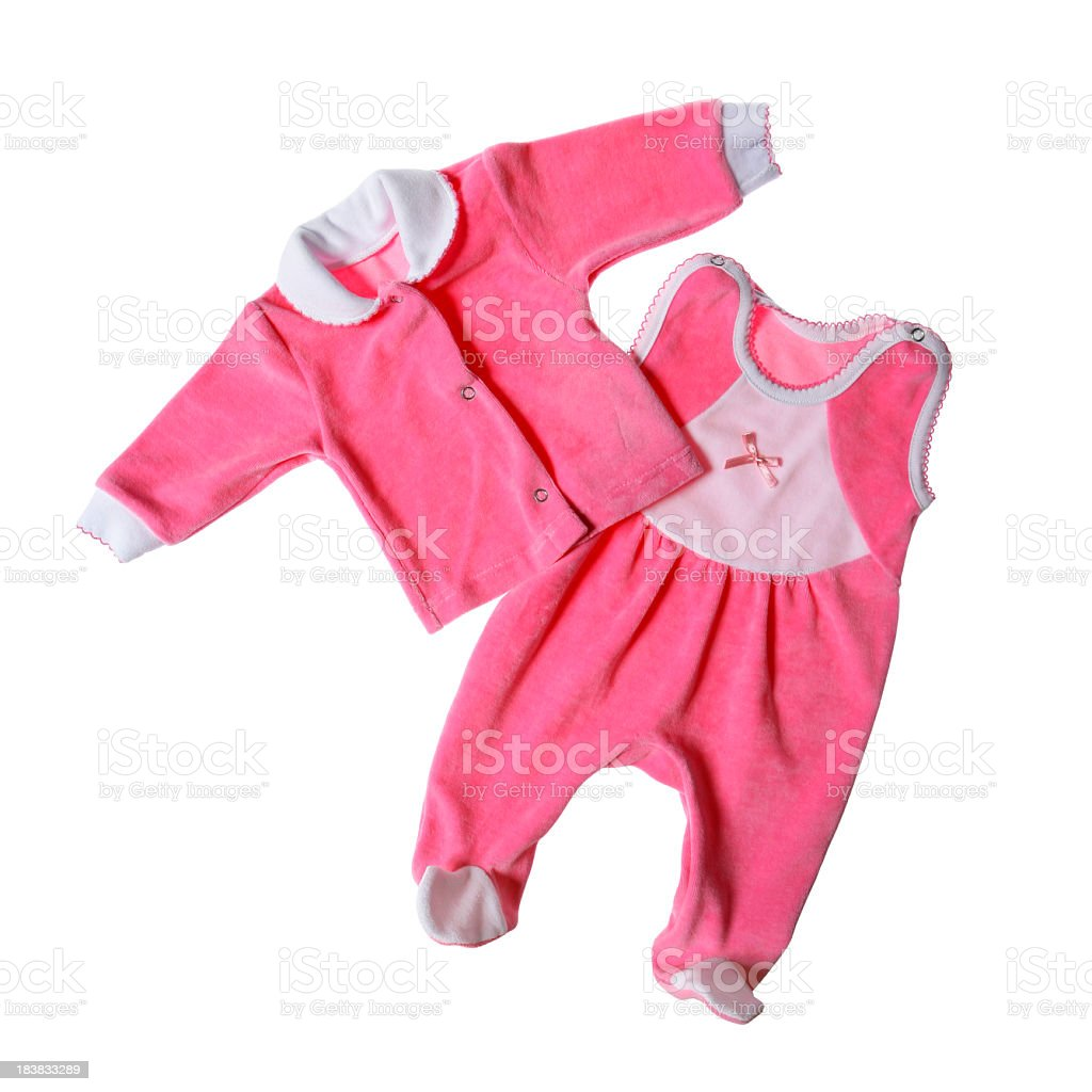 Pink baby clothes on white background stock photo