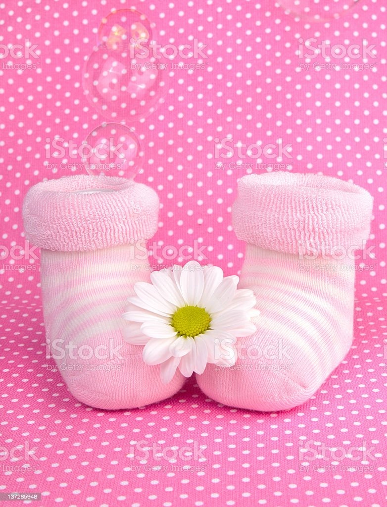 Pink baby girl knitted socks or shoes royalty-free stock photo