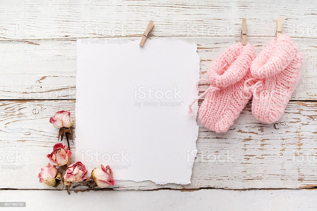 pink baby's booties. Small girls sock and blank card stock photo