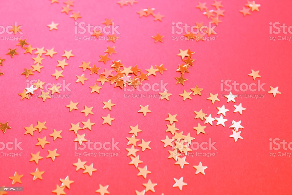 Pink background with white gold stars. stock photo