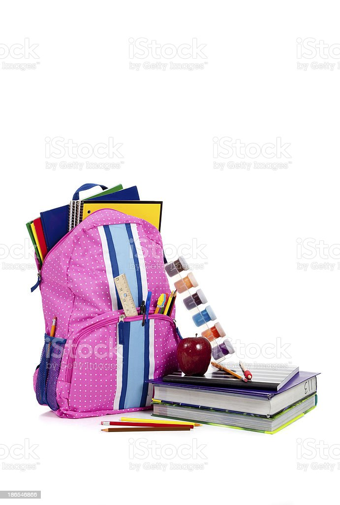 Pink backpack with school supplies and copy space stock photo