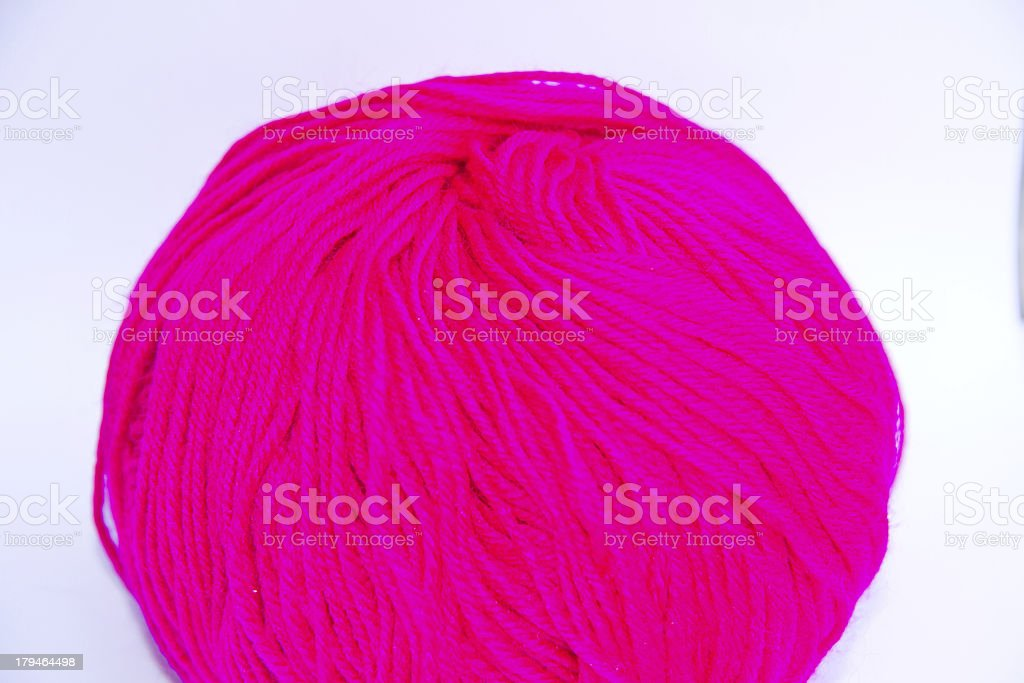 Pink ball of woollen thread isolated on white royalty-free stock photo