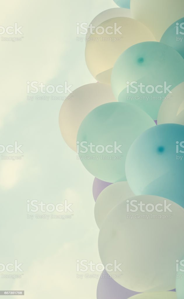 pink balloons background over pastel cloud stock photo