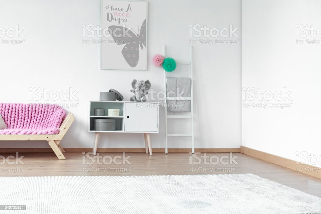 Pink blanket on wooden sofa stock photo