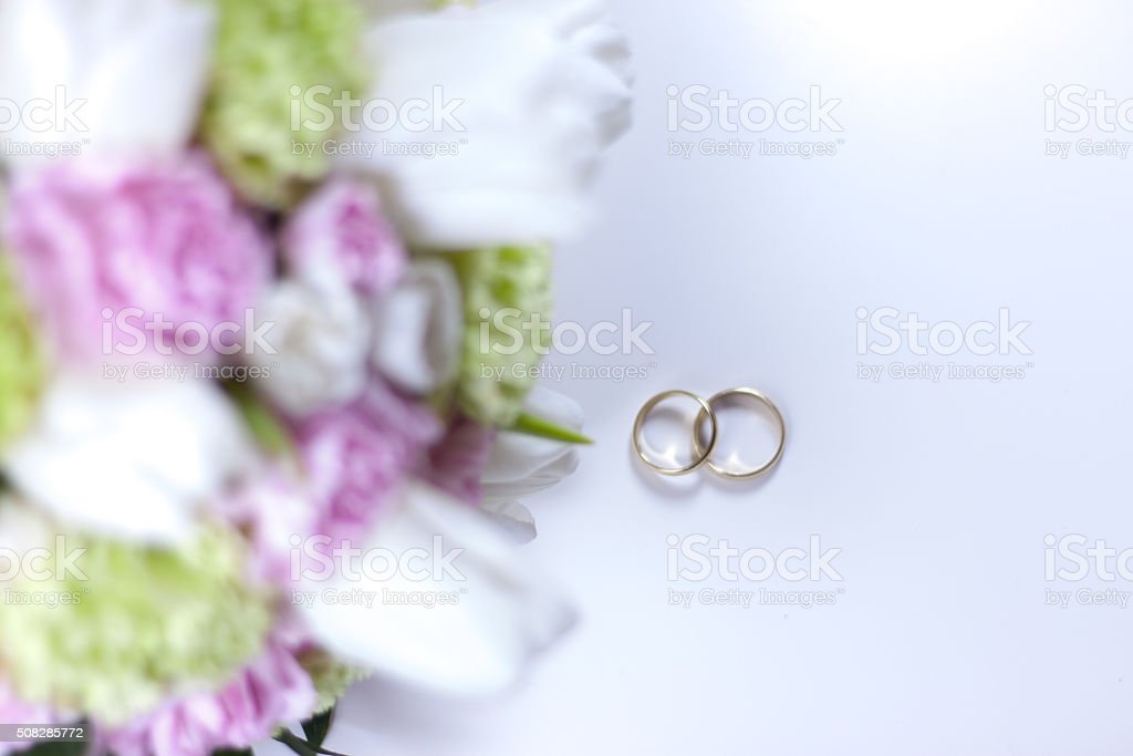 Pink Bouquet and rings - Stock Image stock photo