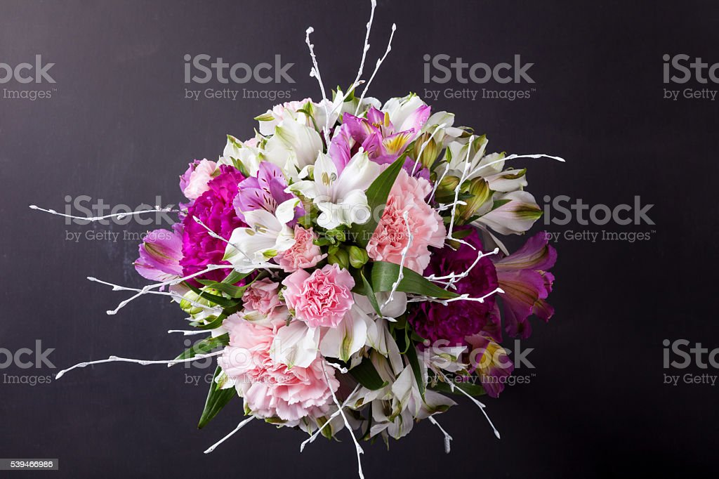 Pink bouquet from gillyflowers and alstroemeria on blackboard, t stock photo