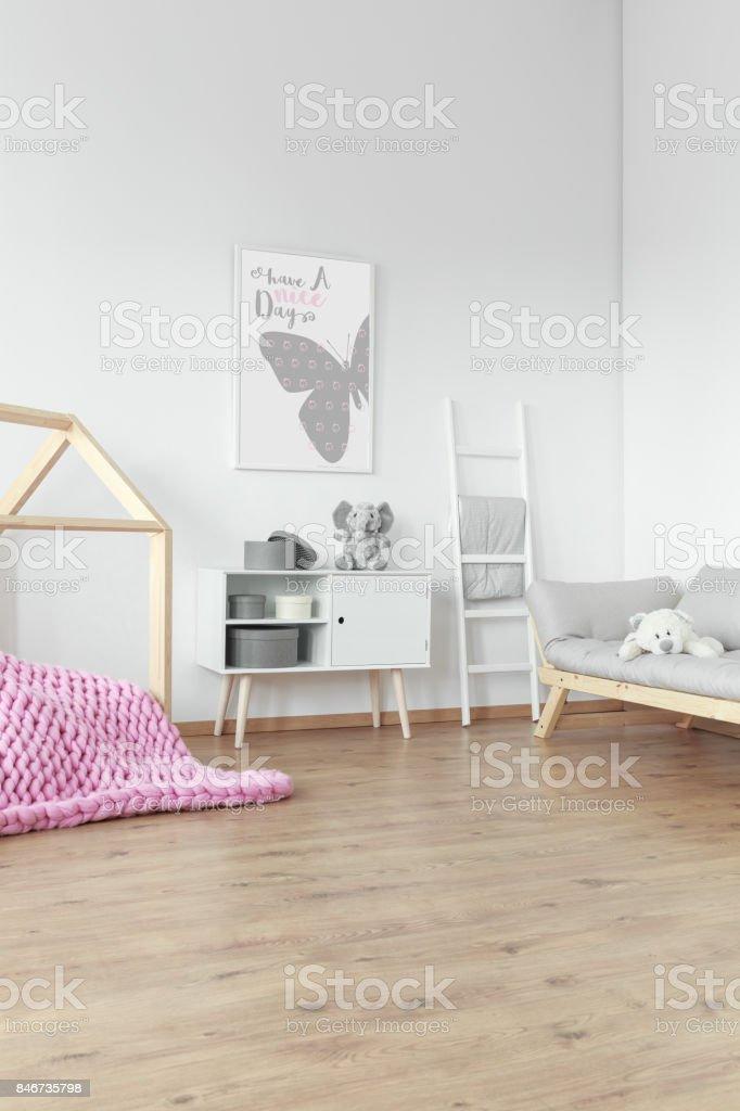 Pink braided blanket on floor stock photo