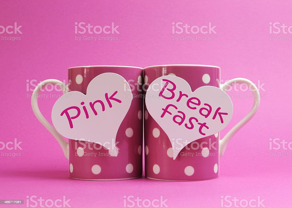Pink Breakfast polka dot coffee mugs for charity awareness. royalty-free stock photo