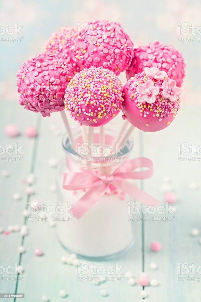 Pink cake pops in a vase stock photo