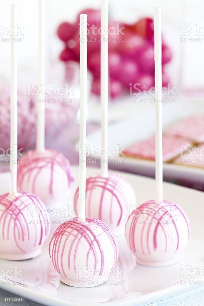 Pink cake pops with dark pink frosting stock photo