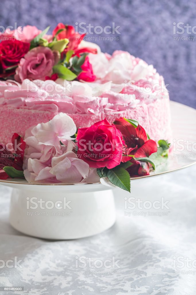 Pink cake with natural beautiful flowers stock photo