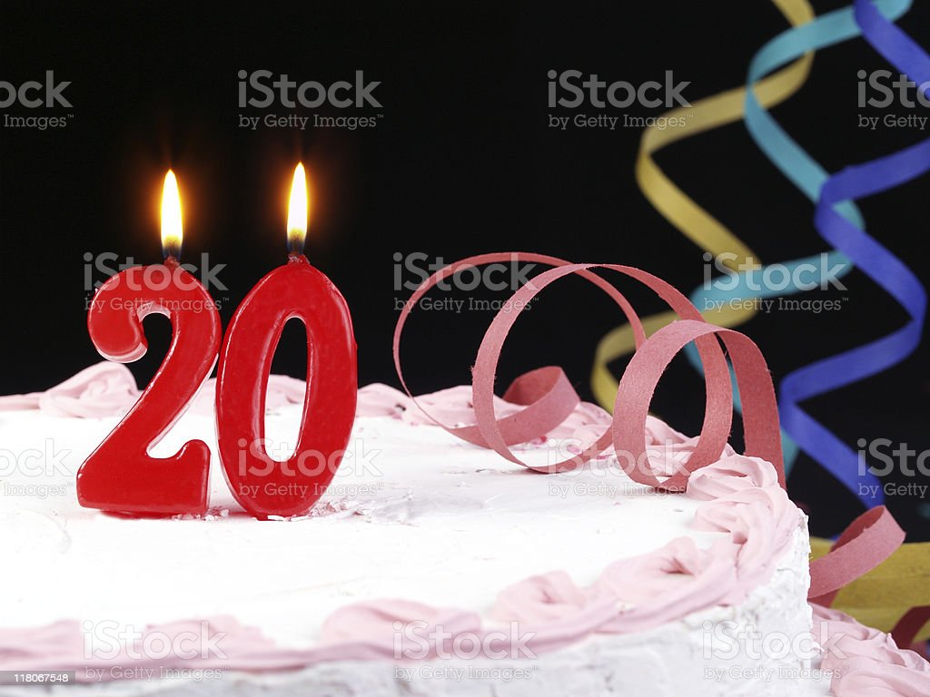 A pink cake with red number twenty candles royalty-free stock photo