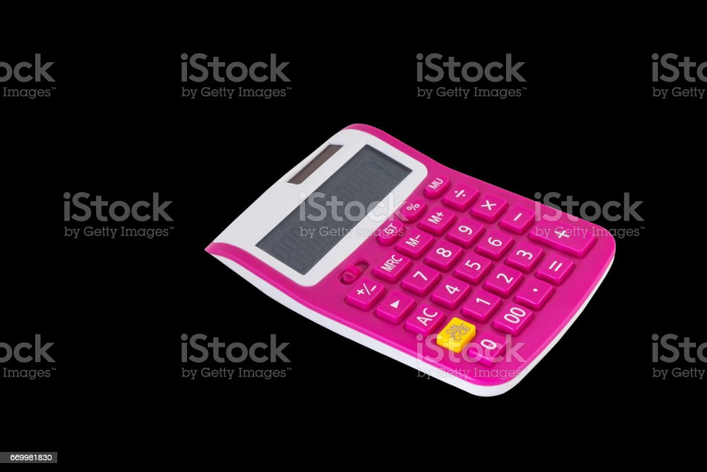pink calculator isolated on a dark background stock photo