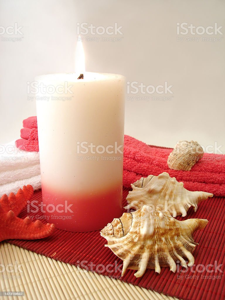 pink candle, towels and seashells royalty-free stock photo