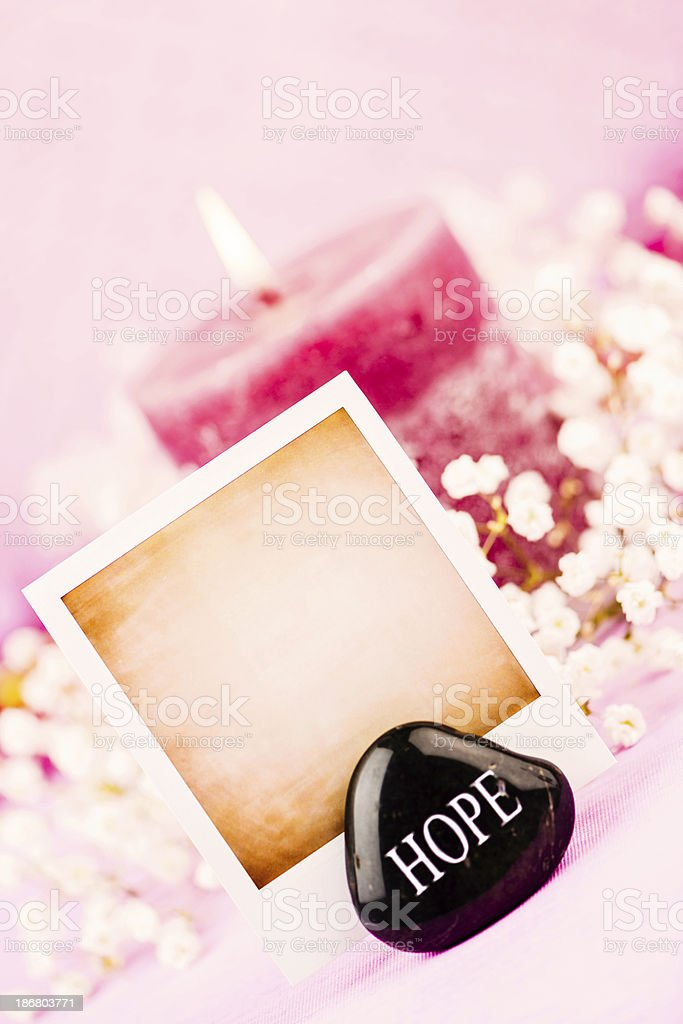 Pink Candle with Photo Frame and Message of Hope royalty-free stock photo
