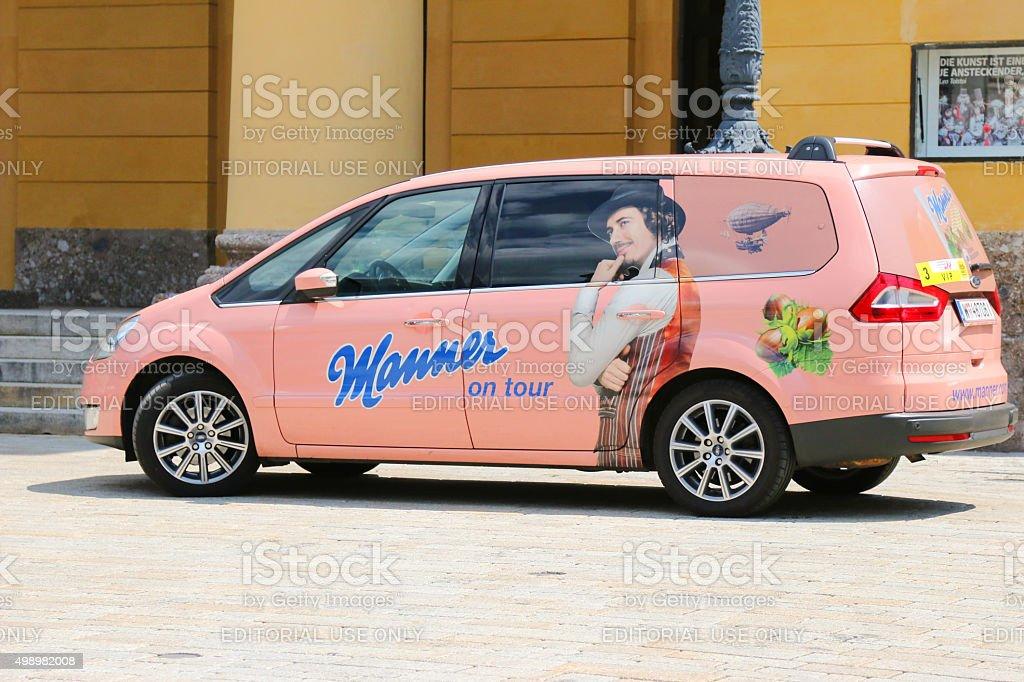 Pink car with sticker Manner on tour in Innsbruck, Austria stock photo