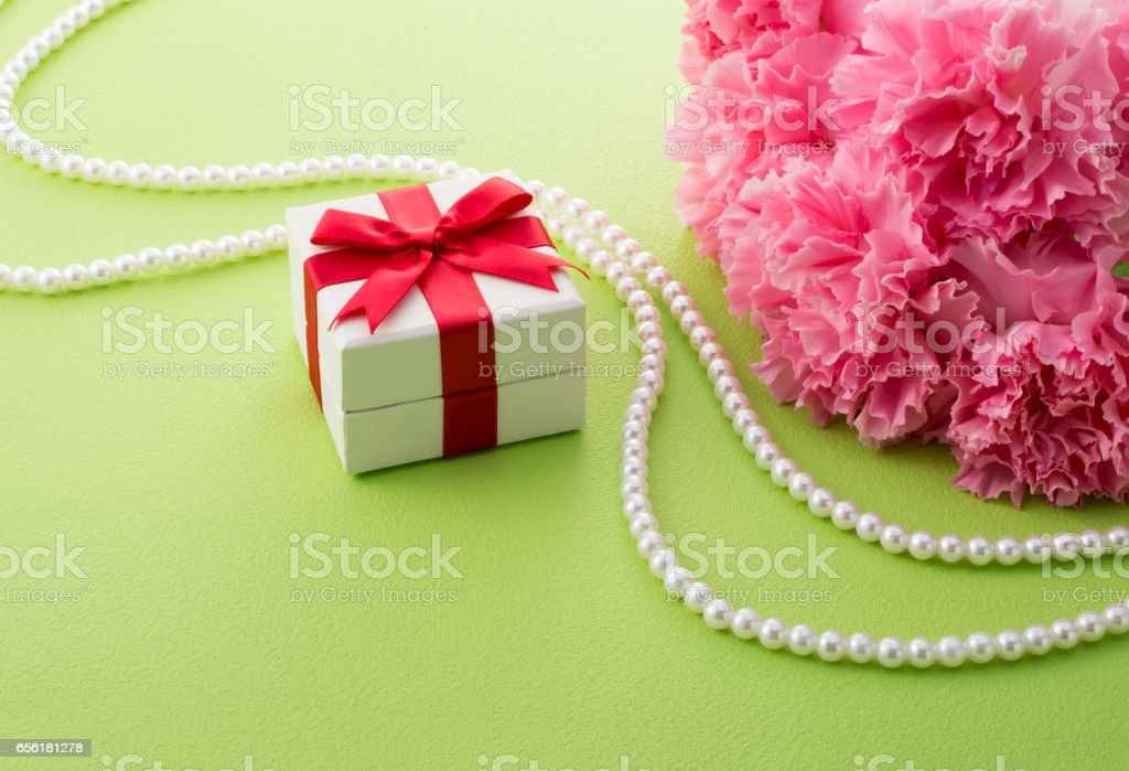 pink carnation and gift box stock photo