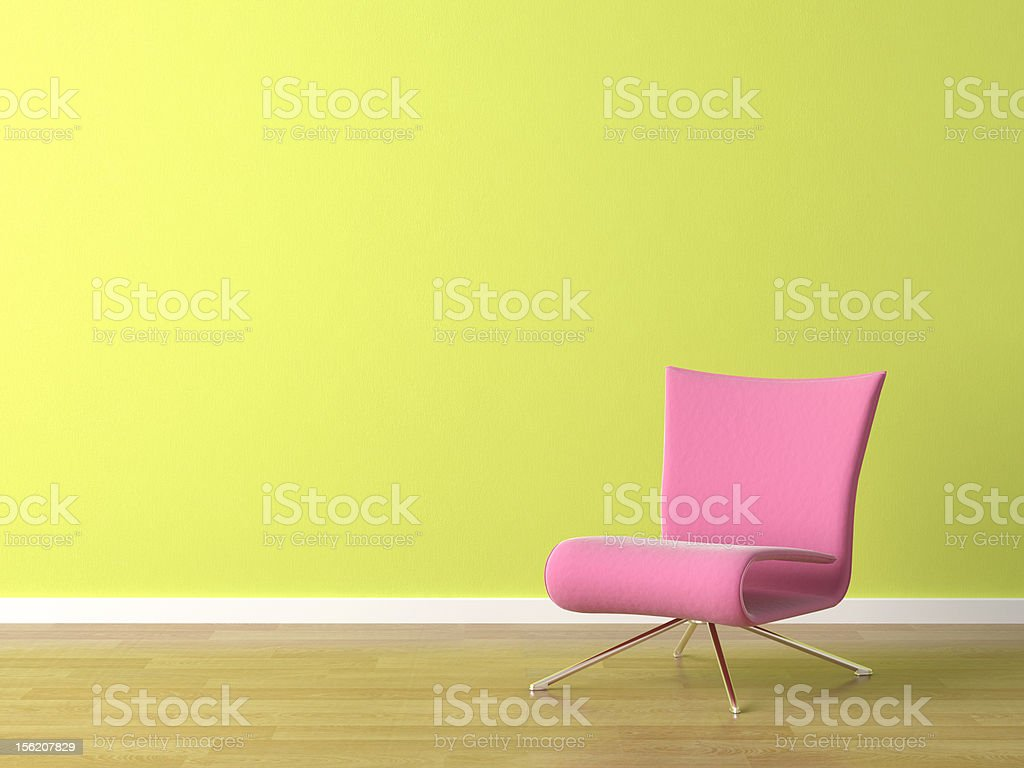 pink chair on green wall royalty-free stock photo