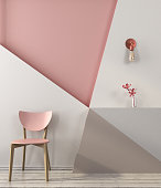 Pink chair on the background of a geometric wall