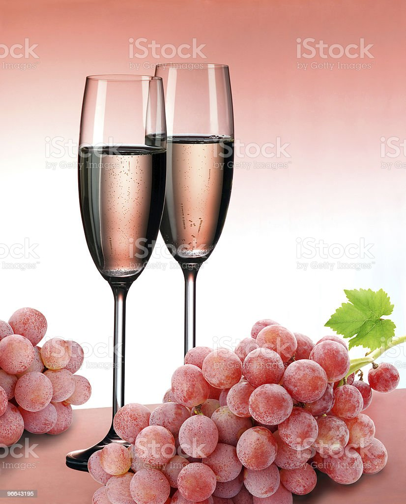 Pink champagne and grapes royalty-free stock photo