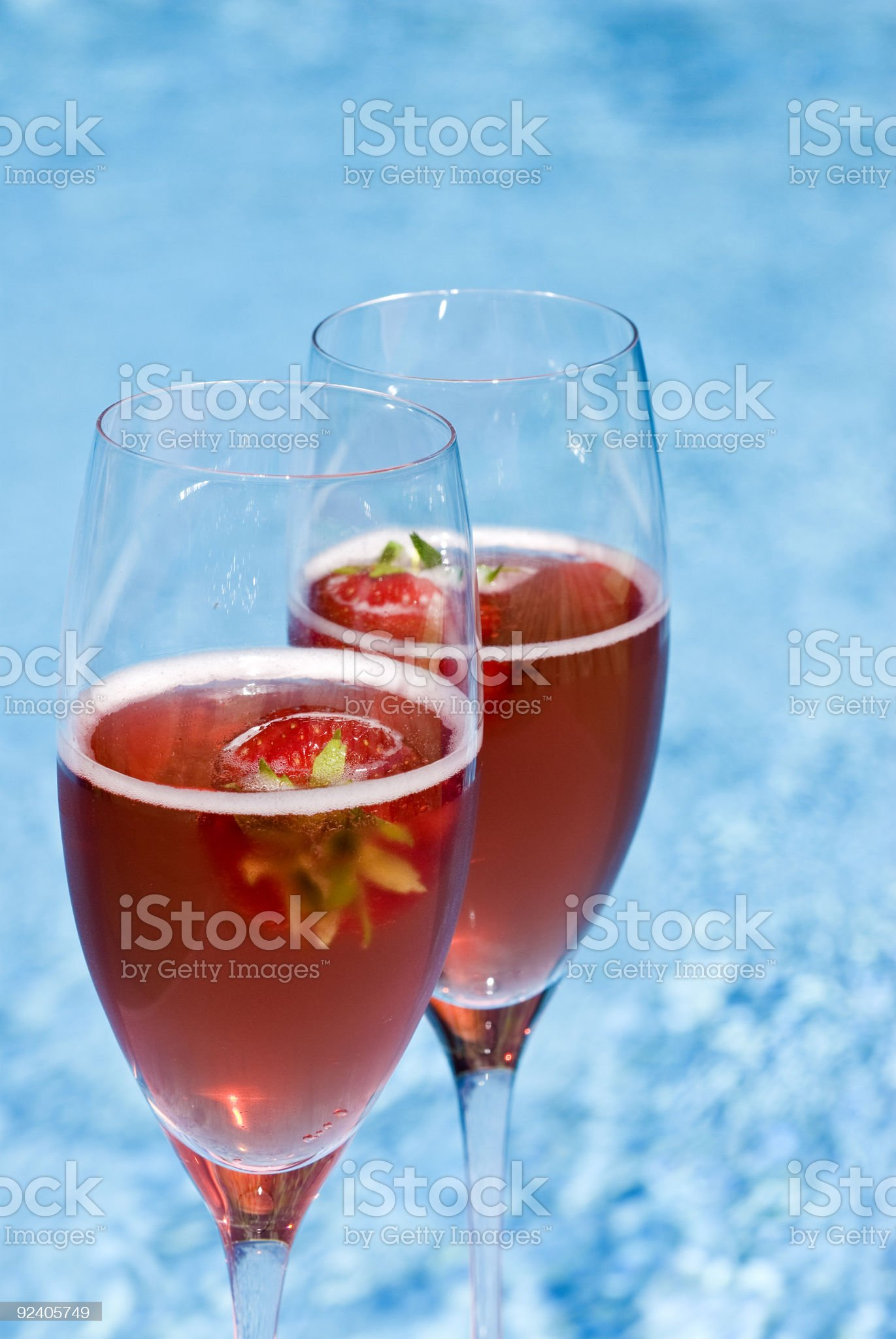 Pink Champagne and Strawberries by the Pool royalty-free stock photo