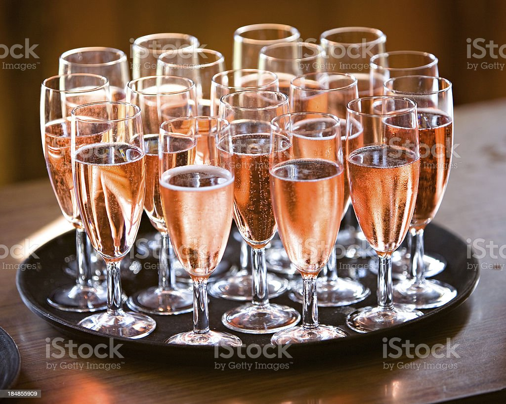 Pink Champagne on table and Black tray stock photo