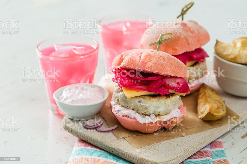 Pink chicken grill burger on wood background stock photo