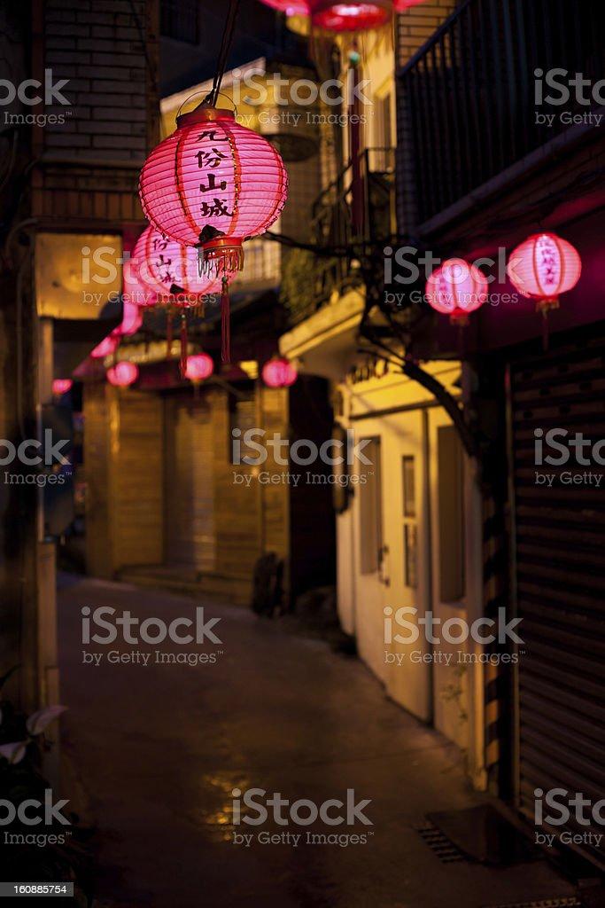 Pink Chinese lantern lighting in old street of Jiufen, Taiwan stock photo
