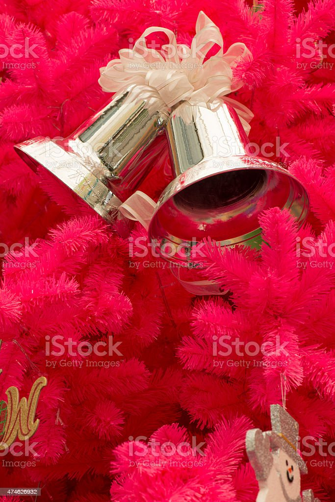Pink Christmas tree with ornaments. stock photo