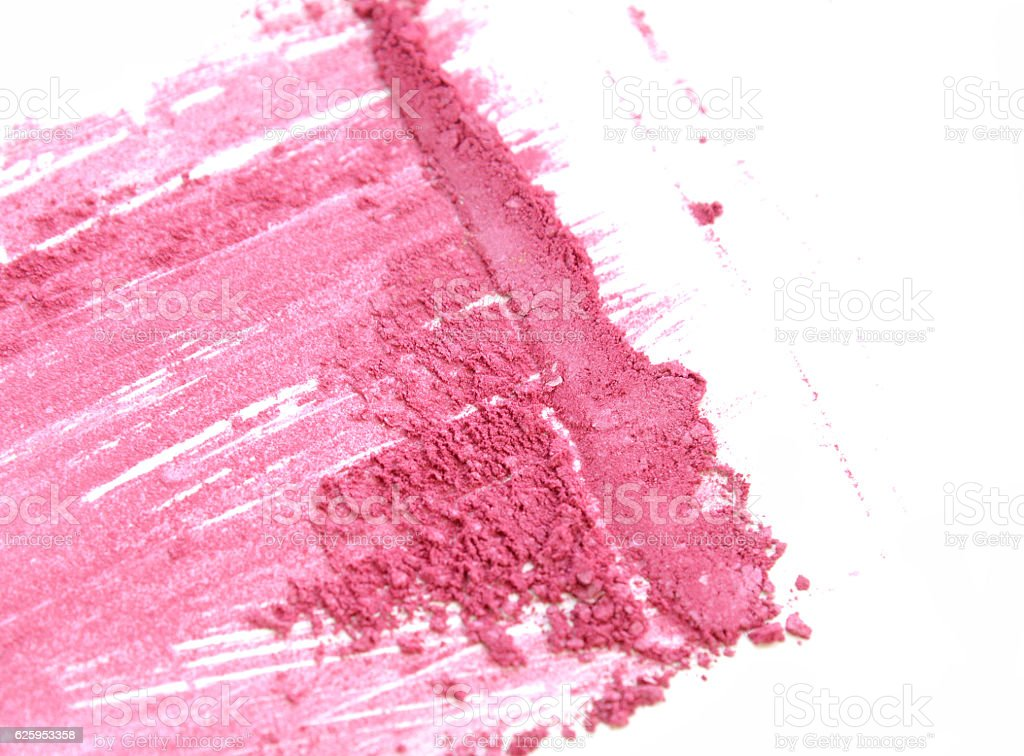 Pink close up crushed make up eye shadow on white stock photo