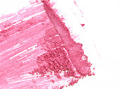 Pink close up crushed make up eye shadow on white
