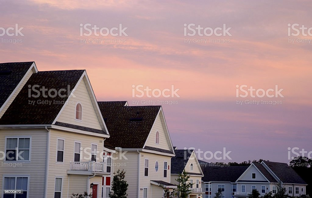 Pink Cloud Sunset over Townhouse Rooftops royalty-free stock photo