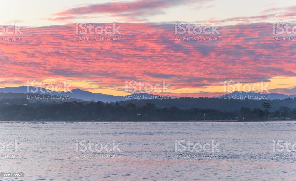 Pink Cloud Sunset Seascape stock photo