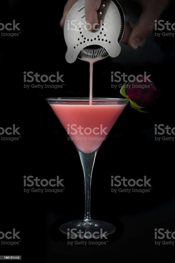 Pink Cocktail against black background stock photo