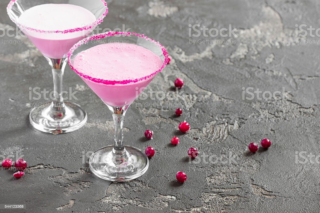 Pink cocktail, milk, and sugar in the glass stock photo