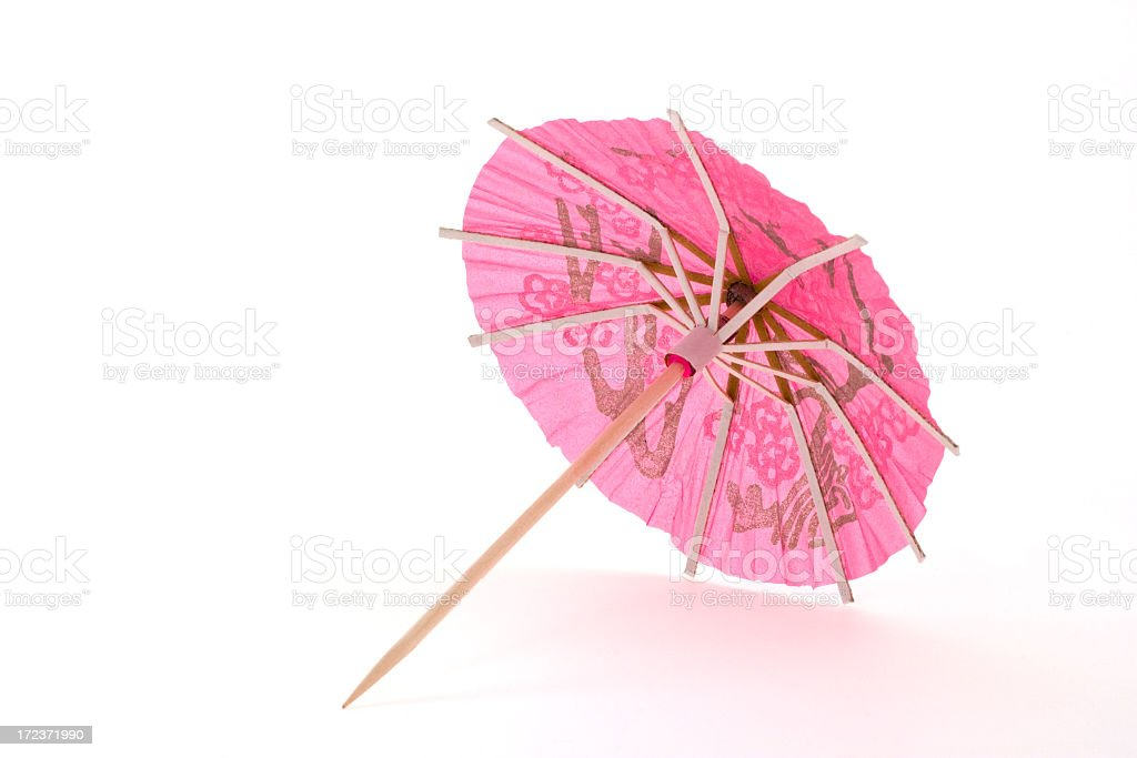 Pink cocktail umbrella stock photo