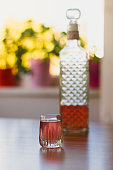 Pink colored liqueur - Stock Image