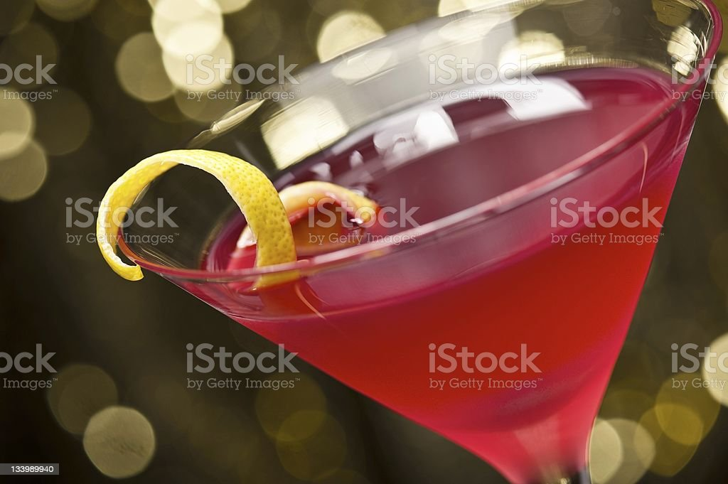 A pink cosmopolitan cocktail with lemon garnish stock photo