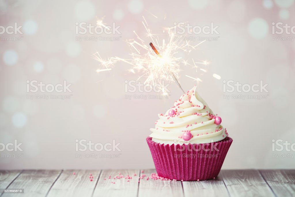 Pink cupcake with sparkler stock photo