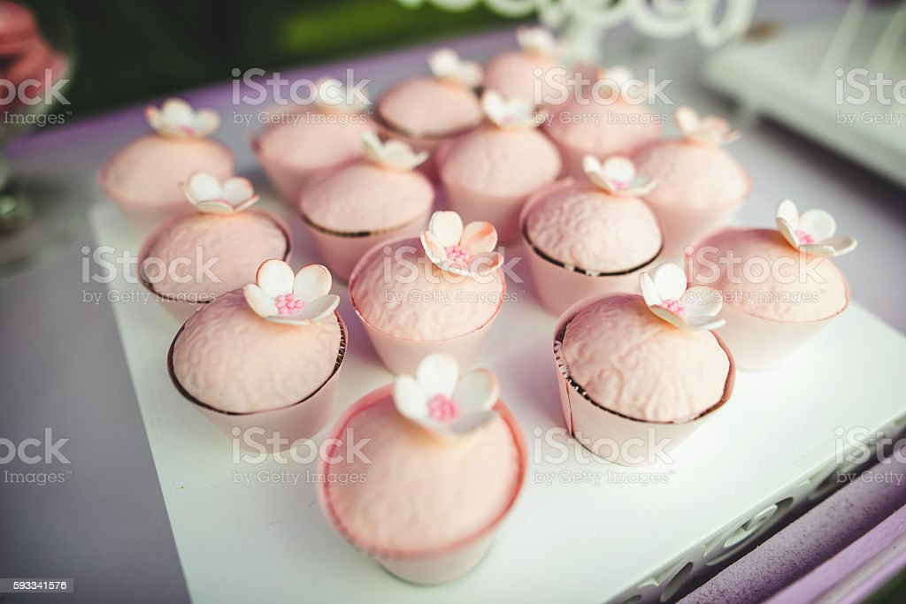 Pink cupcakes with flowers stock photo