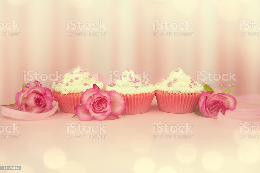 Pink cupcakes with roses. stock photo