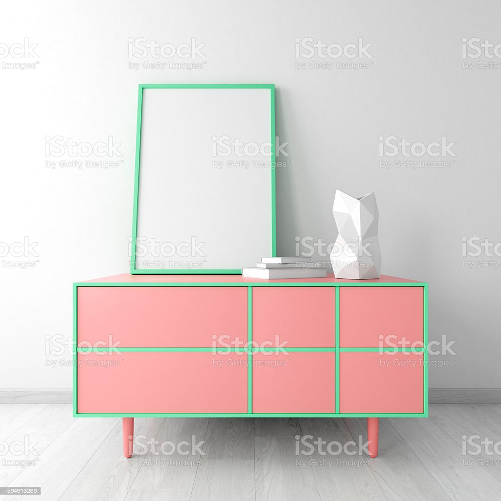 Pink dresser with frame and vase in white room stock photo