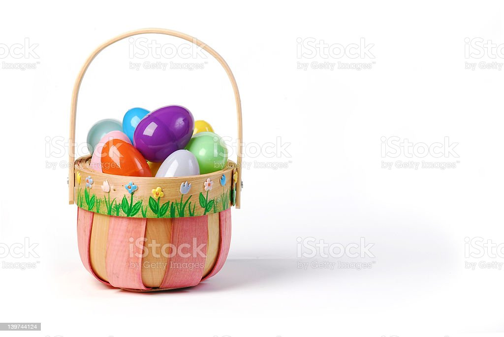 Pink Easter basket with colorful eggs royalty-free stock photo