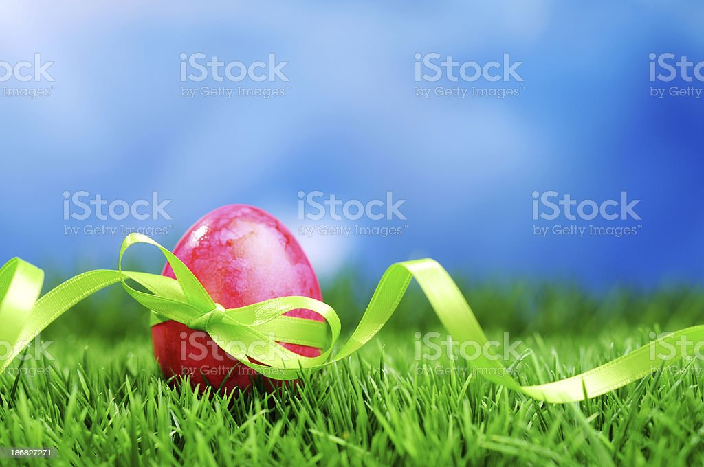 Pink easter egg with a green ribbon royalty-free stock photo