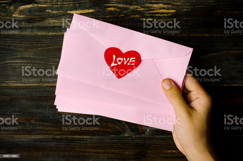 Pink envelope with red heart stock photo
