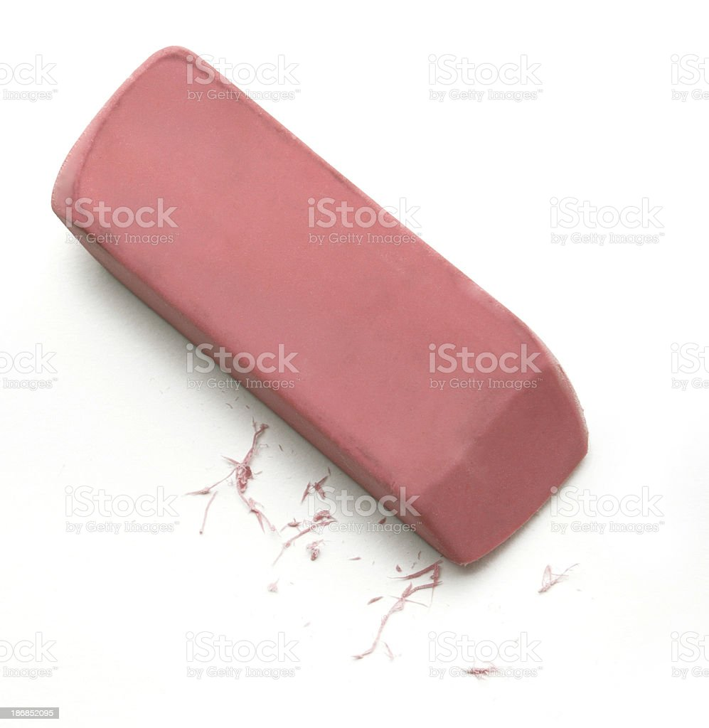 Pink eraser and residue on white background stock photo