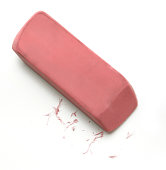 Pink eraser and residue on white background