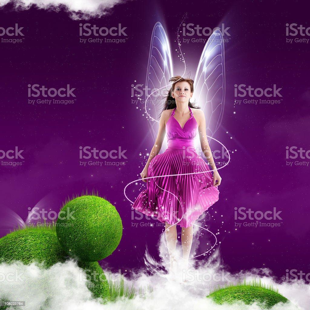 Pink Fairy Woman on Purple Background stock photo
