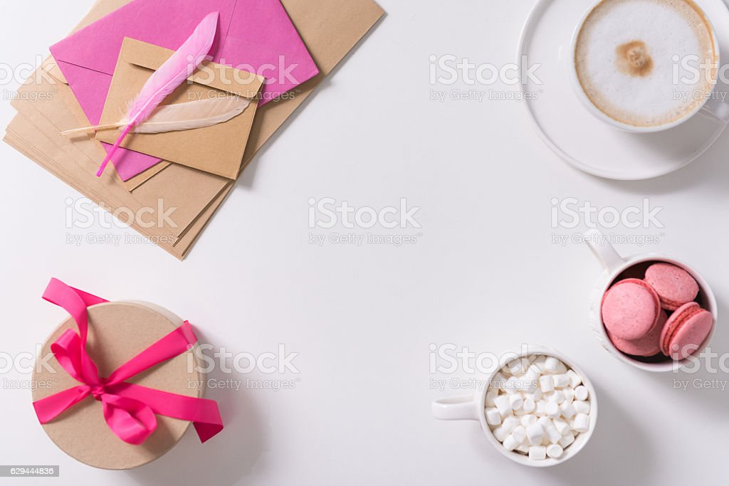 Pink feathers lying on the pile of envelopes stock photo